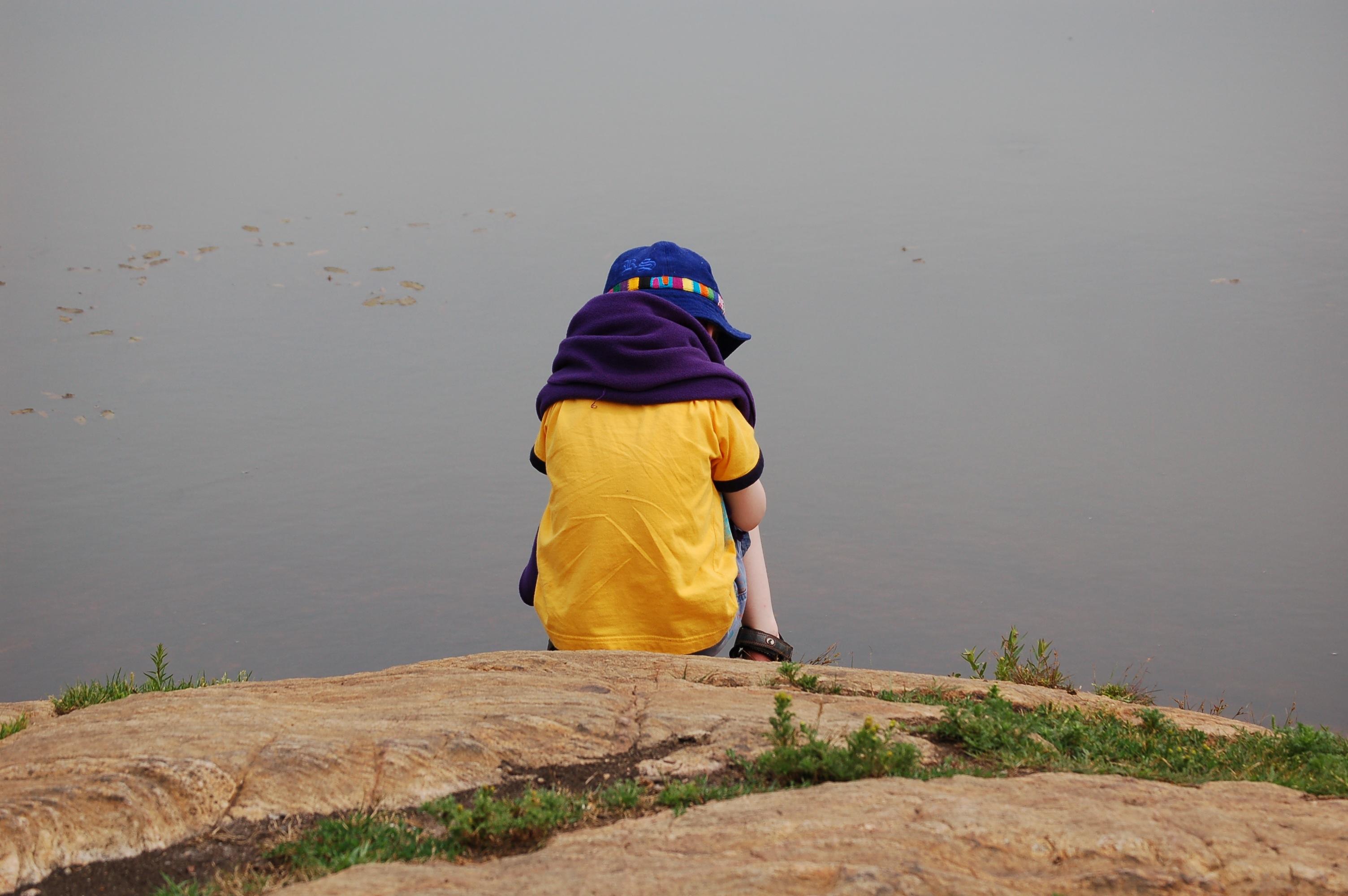 Child sitting on rock